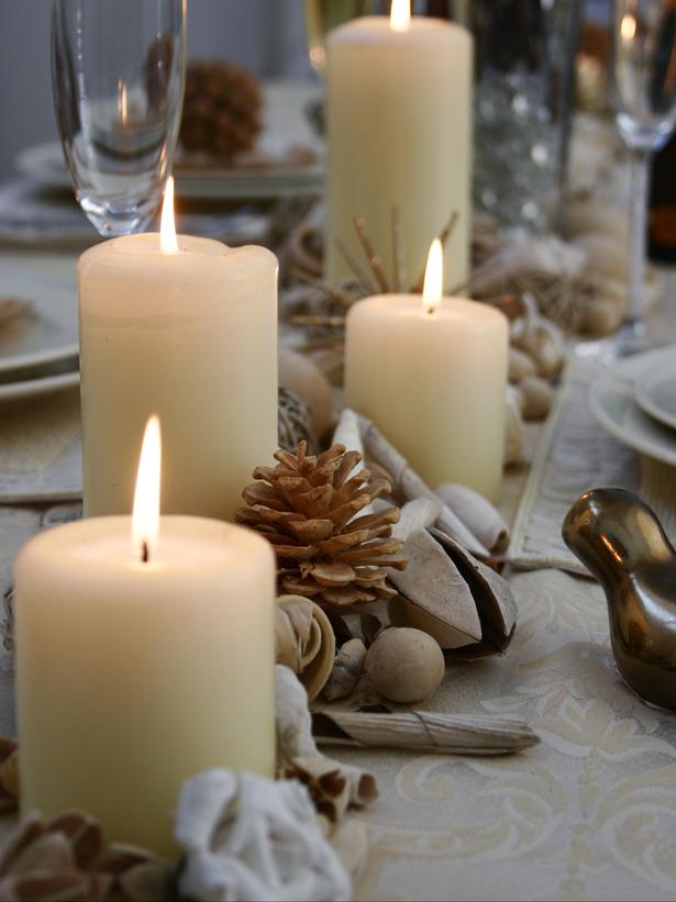 Natale decorare la tavola candele frutta secca blogmamma - Decorare candele per natale ...