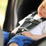 Boy sleeping in child car seat