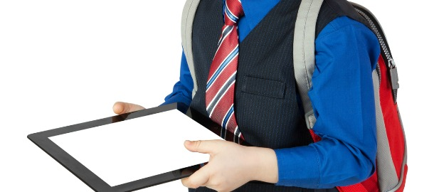 Little boy goes to school with digital tablet
