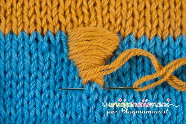 cappellino a forma di gufo becco