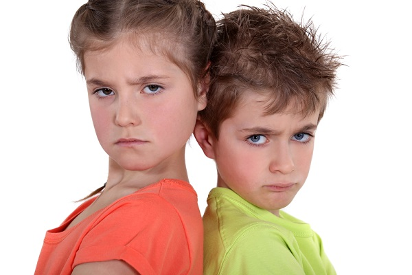 two angry kids posing together